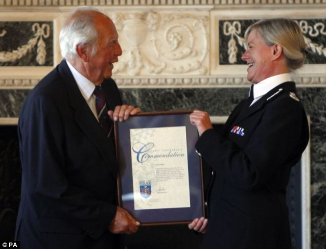 Well done: Keith Milner, who worked on the case of the Great Train Robbery, at a ceremony where he received a commendation from current Thames Valley Police Chief Constable Sara Thornton at Eynsham Hall, Witney, Oxfordshire