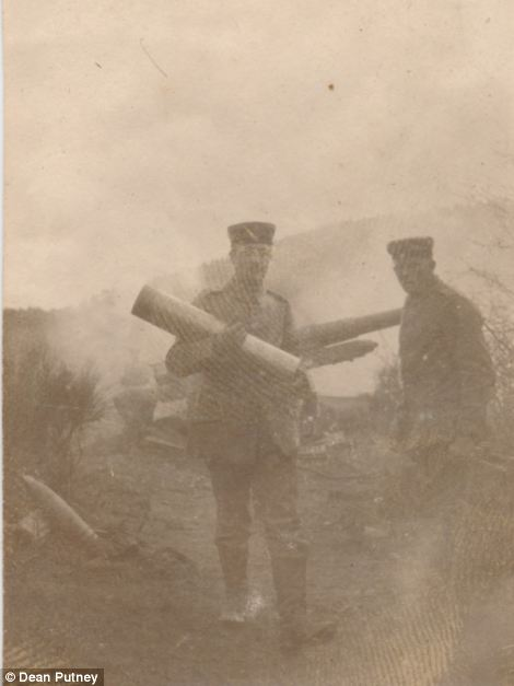 Mr Putney said the images, such as this one of soldiers carrying heavy artillery