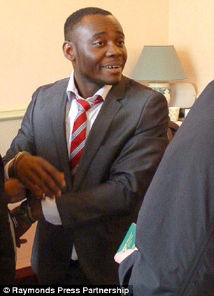 Nigerian student Chinedu Amadi, 27, pictured being arrested by Home Office investigators at Leicester Registry Office