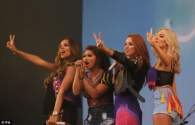 The girls flash a peace sign as they perform at Hyland's Park in Chelmsford, south Staffordshire