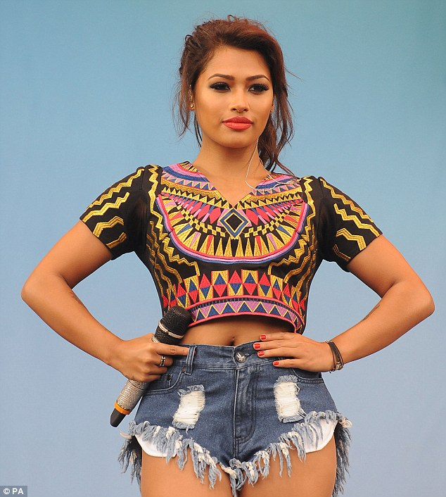 Vanessa White shows off her Aztec print top at during her band's performance on Saturday