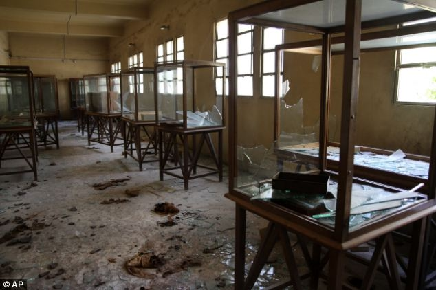 Ransacked: Rows of display cases are broken and empty at the Malawi Antiquities Museum