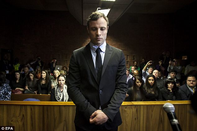 Emotional: A visibly emotional Pistorius stood silently in the dock as he was formally indicted for premeditated murder at Pretoria Magistrates' Court