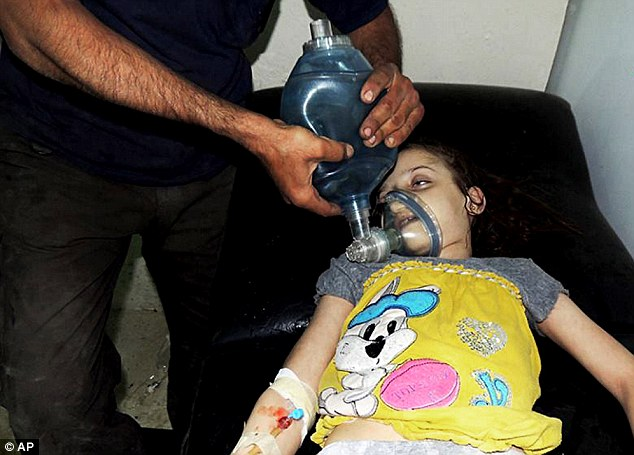 Victim: A Syrian girl receiving treatment at a makeshift hospital, in Arbeen, Damascus