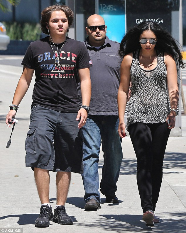 Three's company: The pair hardly got much privacy, with a bodyguard walking closely behind them