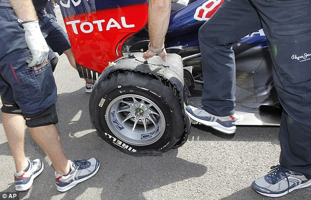 Close-up: Vettel's right-rear tyre is closely examined by Red Bull mechanics