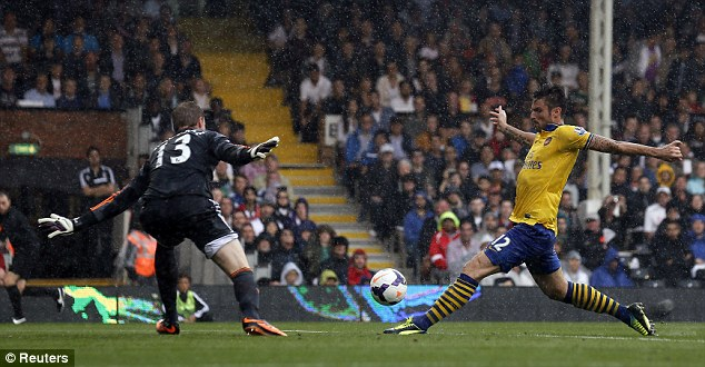 Cool: Olivier Giroud was calm in front of goal as he opened the scoring