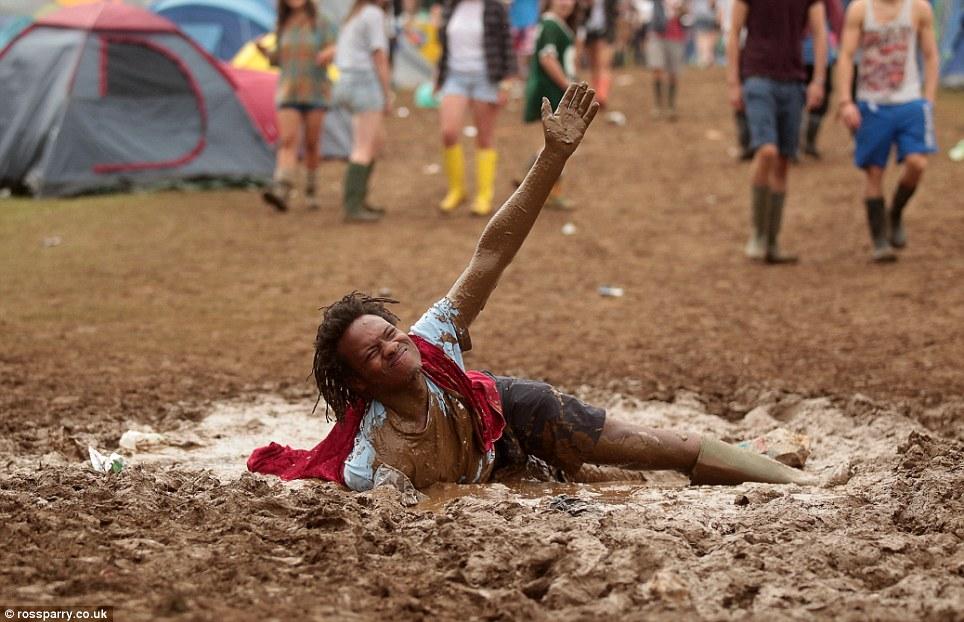 Image result for black man stuck in mud