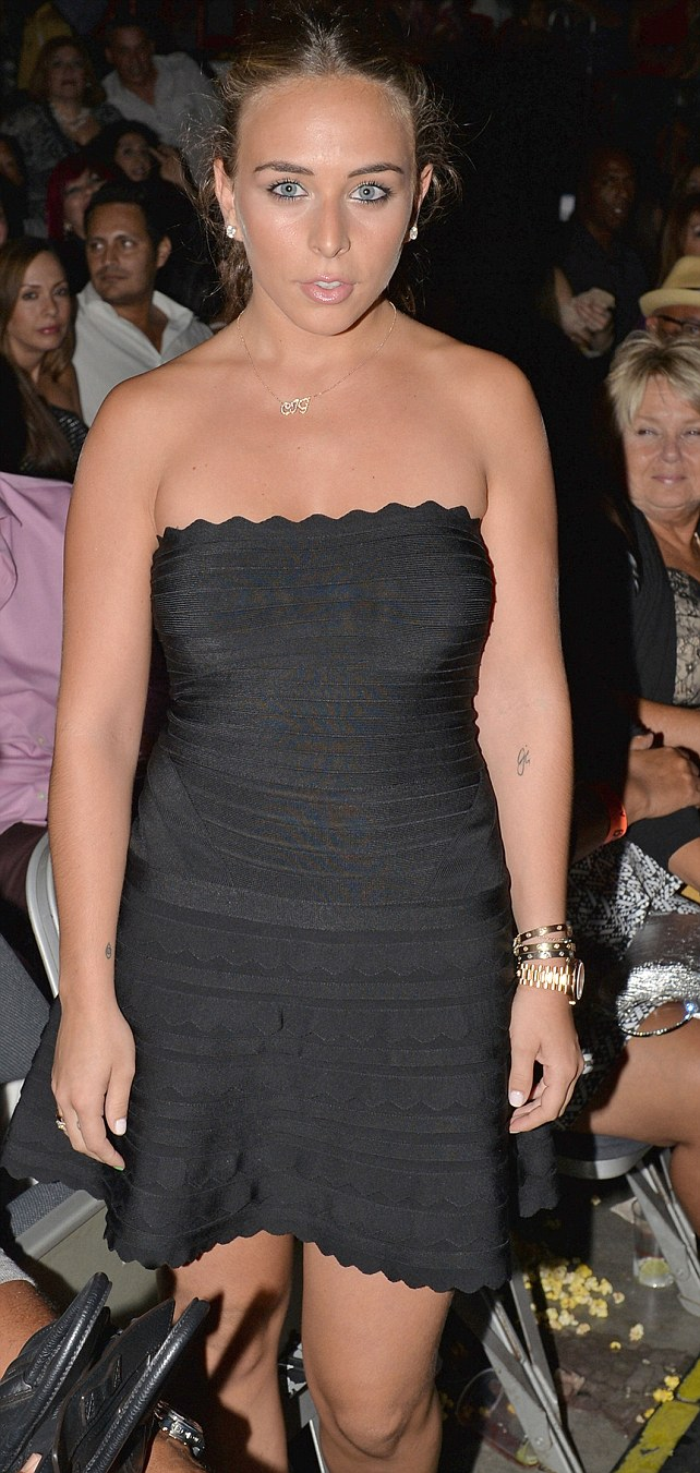 Little black dress: Chloe wore a beautiful Hervé Léger dress and accessorised with lots of jewellery