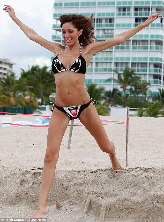 One giant leap: Farrah Abraham leaps across the sand on the beach in her bikini