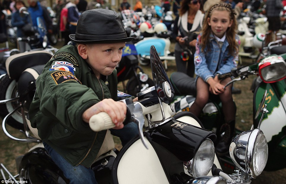 Next generation mod: Children get involved in the fun at the scooter festival which took place this bank holiday weekend  Read more: http://www.dailymail.co.uk/news/article-2402039/We-mods-Thousands-gather-worlds-largest-moped-festival-Isle-Wight.html#ixzz2duhK8lGs  Follow us: @MailOnline on Twitter | DailyMail on Facebook