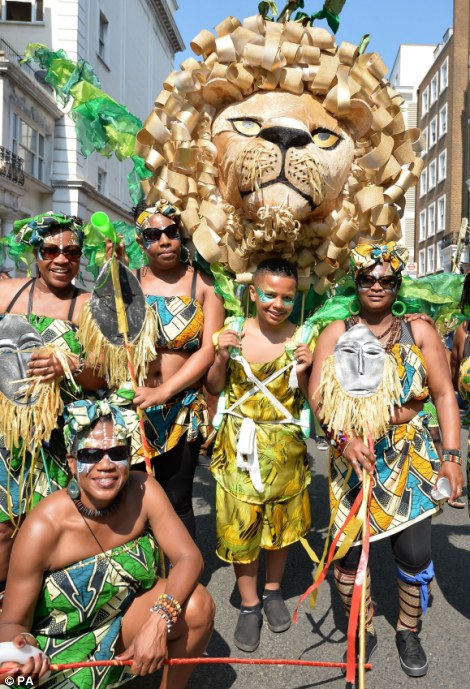 Entertainers take part in the Notting Hill Carnival in west London