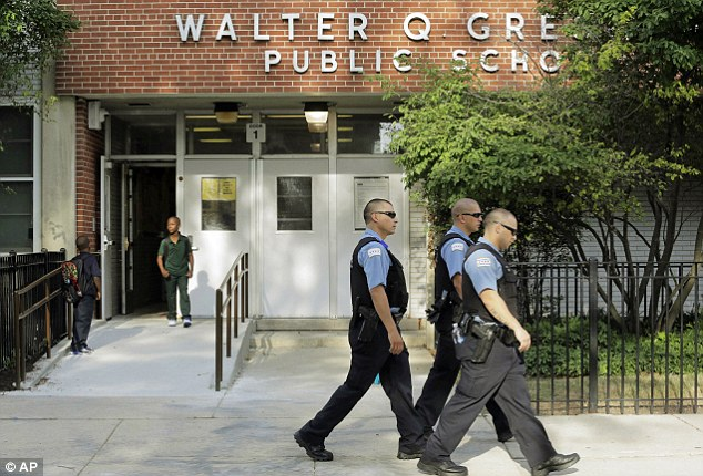 Chicago Police patrol the neighborhood as children arrive at Gresham Elementary School