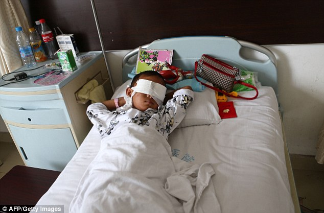 Horrific: A Chinese boy lies in hospital after he had his eyes gouged out reportedly by an organ trafficker