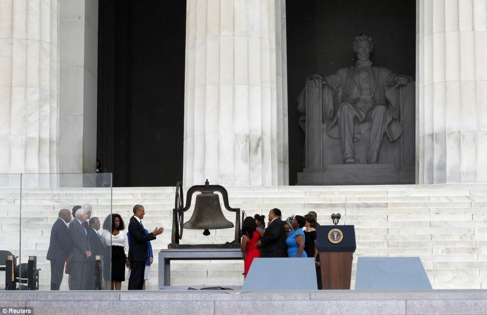 Ceremony: Obama watches on as members of Martin Luther King Jr's family ring a bell beneath the Lincoln Memorial during the ceremony