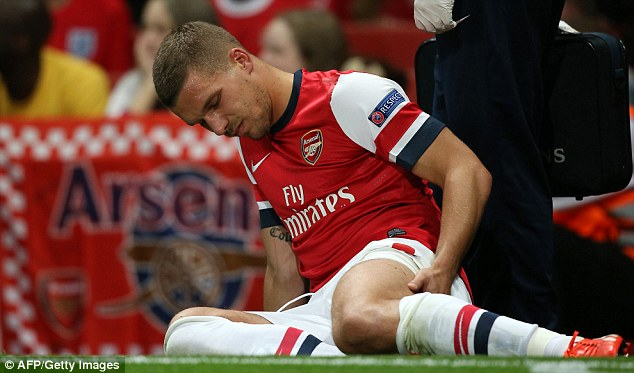 Blow: Lukas Podolski has been ruled out of action for up to 10 weeks with a hamstring injury