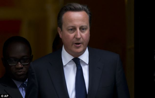 Legal advice: Prime Minister David Cameron leaves Downing Street for the Commons debate on Syria