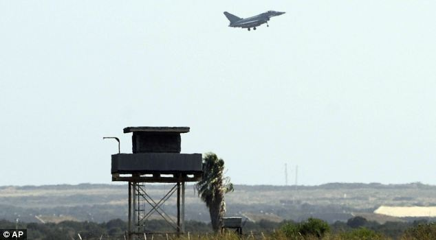 Prudent: An RAF Typhoon jet comes in to land at Akrotiri in Cyprus today as a 'prudent and precautionary measure', the Ministry of Defence said