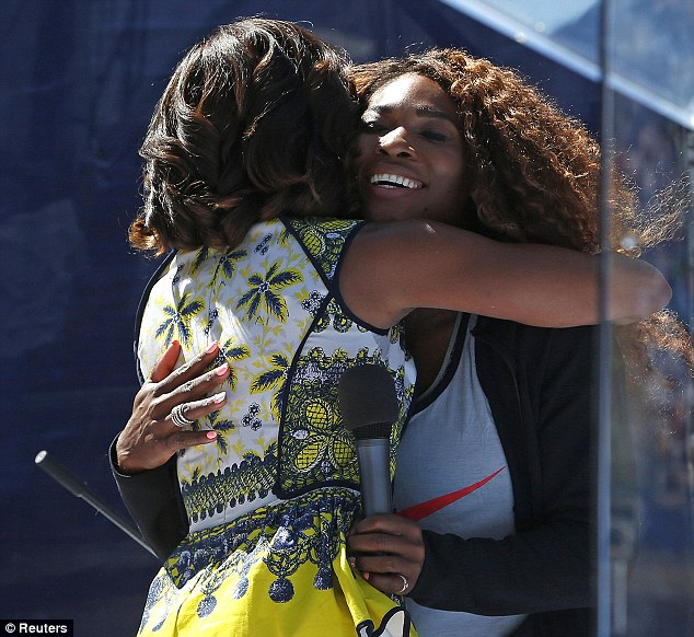 Friends in high places: Serena Williams laughed as she received a hug from First Lady Michelle Obama on Saturday during a US Open event in New York City