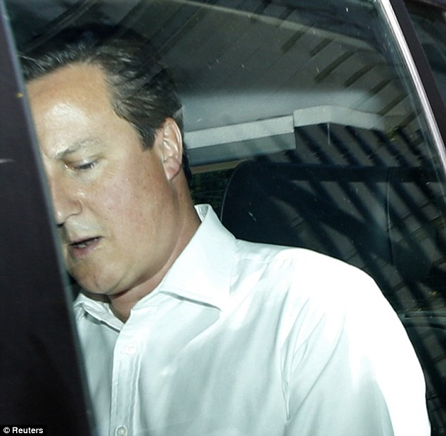 Britain's Prime Minister David Cameron is driven away from the rear of Number 10 Downing Street