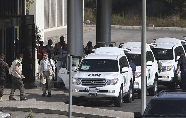 Leaving: U.N. experts arrive at the entrance of the private jet terminal at Beirut international airport Lebanon, following their departure from Syria