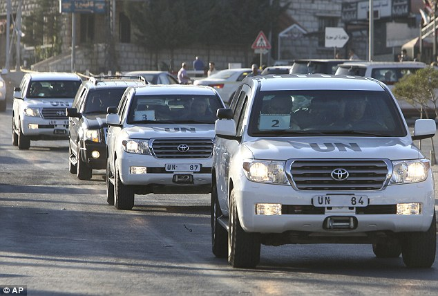 Departure: U.N. weapons experts are pictured crossing into Lebanon today after leaving Syria earlier than expected - prompting fears an attack by the U.S. could begin tomorrow