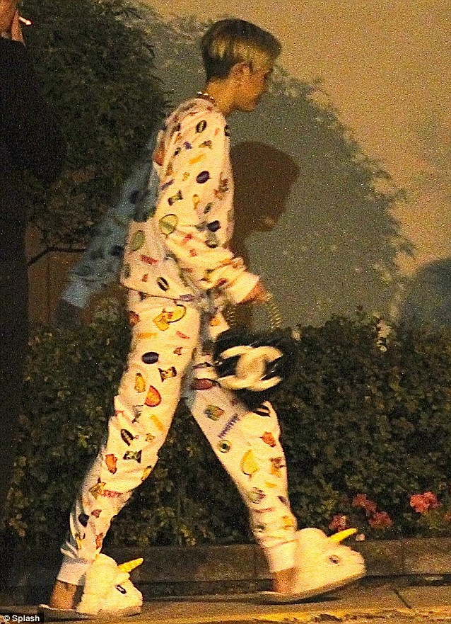 Well she does have a designer bag: Miley carries a Chanel handbag to give some formality to her pyjama look
