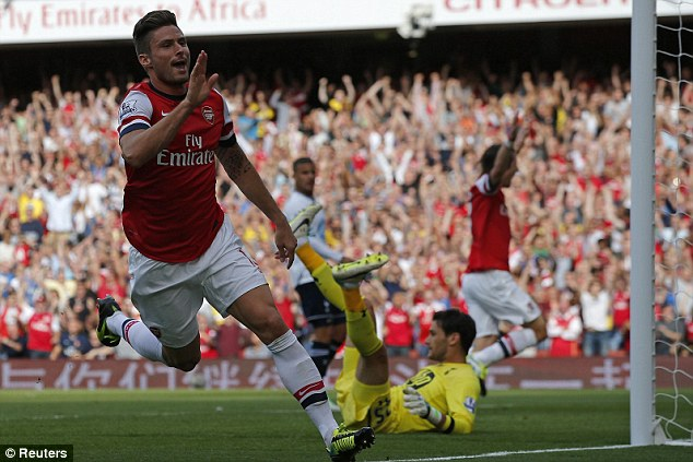 London boy: Olivier Giroud scores and celebrates the opening goal of the game at the Emirates
