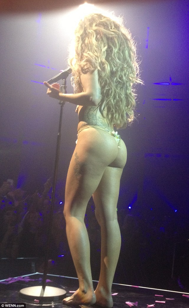 There it is: Lady Gaga fails to see the importance of trousers as she steps on in a shell and seaweed thong