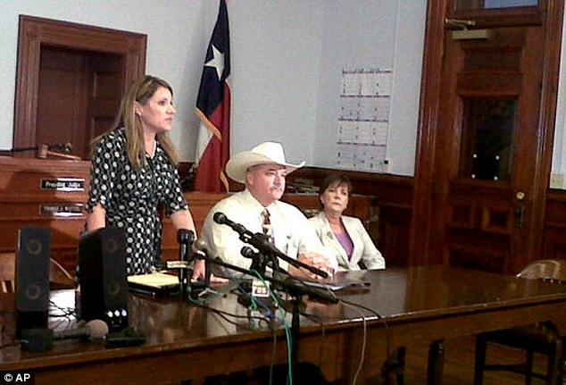 Decision: Heather McMinn, district attorney for Guadalupe, Gonzales and Lavaca Counties, speaks at a news conference with Lavaca County Sheriff Micah Harmon, second from right, and V'anne Huger, right, attorney for the father, in June