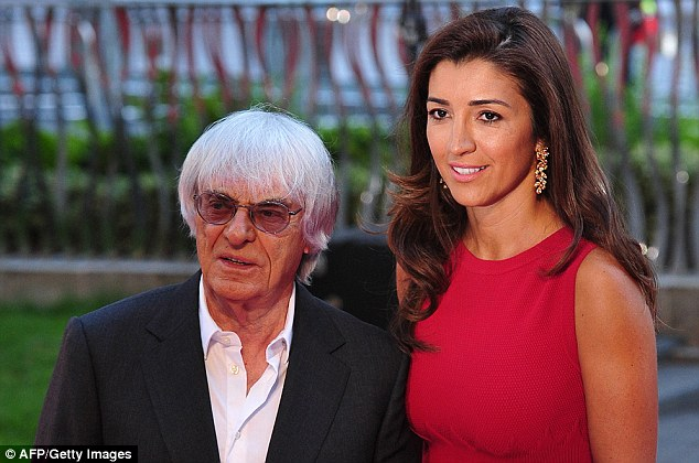 The Boss: And F1 chief Bernie Ecclestone (left, with Brazilian wife Fabiana Flosi)