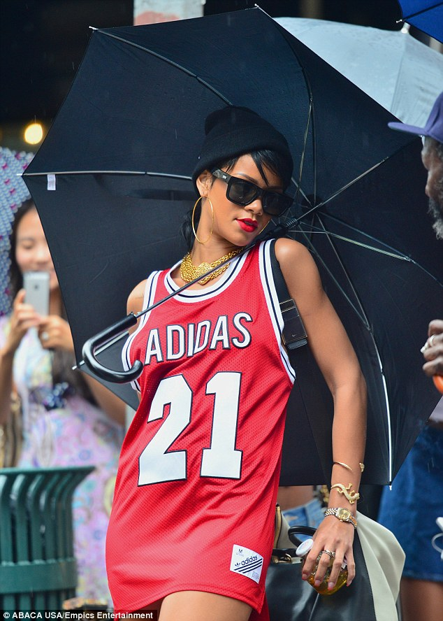 Striking a pose: Rihanna wore a black beanie and shielded her eyes with black shades, complementing her dress with crimson lips