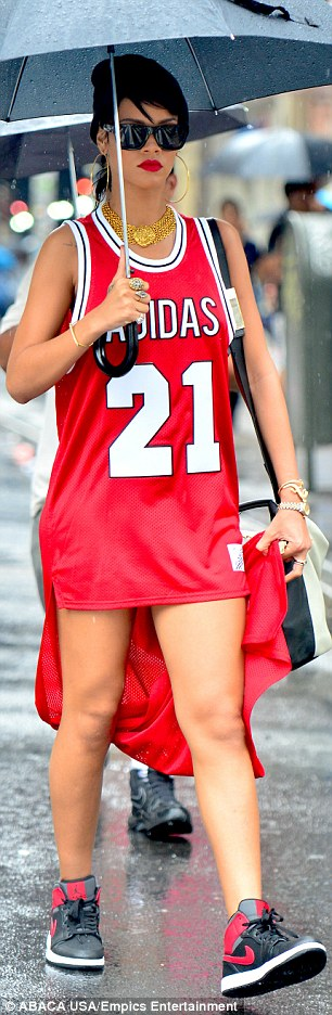 RiRi the athlete: In keeping with the sporty theme, Rihanna paired the dress with navy blue and red high top trainers and accessorise with a large brown shoulder bag