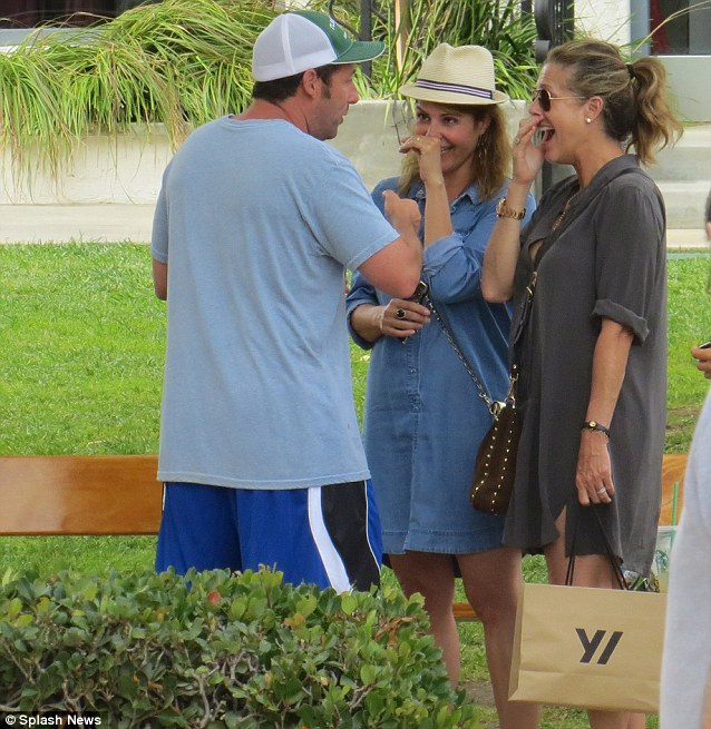 Jokester off-screen: After lunch, the comedian had a good laugh with Nia Vardalos, middle, and Rita Wilson, right, after running into them in the park