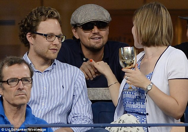 You can't hide: Although Leo tried to keep his identity hidden with a newsboy cap and large sunglasses, his fellow spectators clearly recognised him