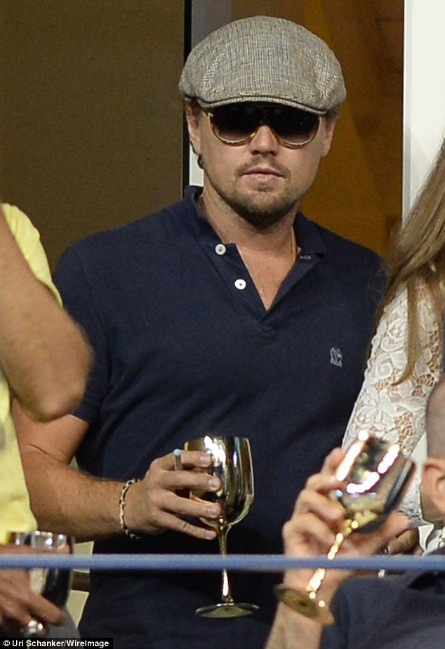 Fit for a king: Hollywood star Leonardo DiCaprio drank from a gold goblet as he watched Serena Williams sail to victory at the US Open quarter-finals