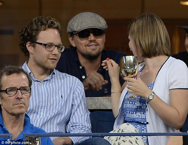 Friendly: Although he was engrossed in the game most of the time, DiCaprio was happy to chat to fellow spectators on Tuesday