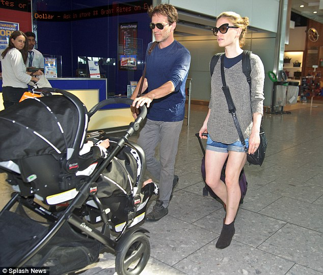 Mixed feelings: Anna Paquin and husband Stephen Moyer looked in serious mode as they jetted out of Heathrow with their twins on Wednesday