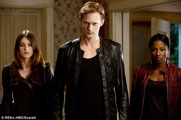 Breakout performance: Alexander Skarsgard as vampire Eric Northman became beloved by fans, pictured with Lucy Griffiths and Rutina Wesley