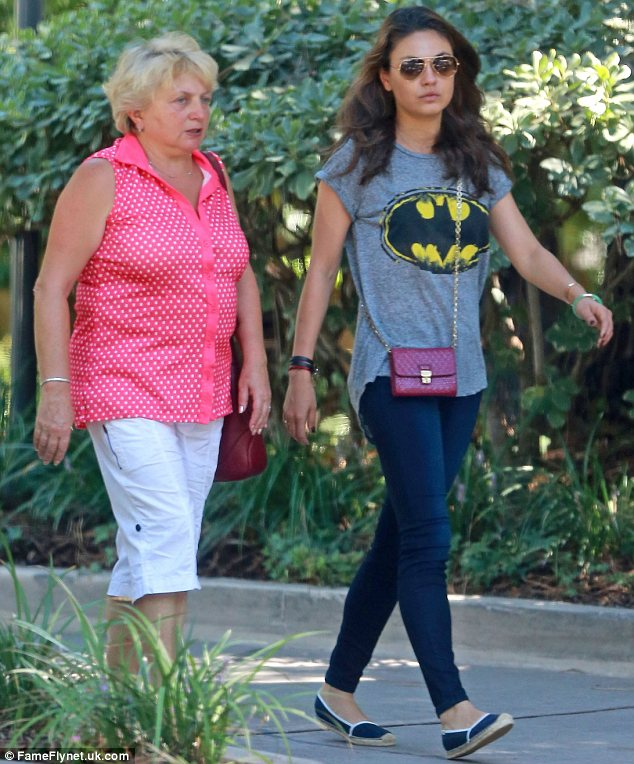 Lots of catching up to do: Mila and her grandmother were deep in conversation as they went for a stroll