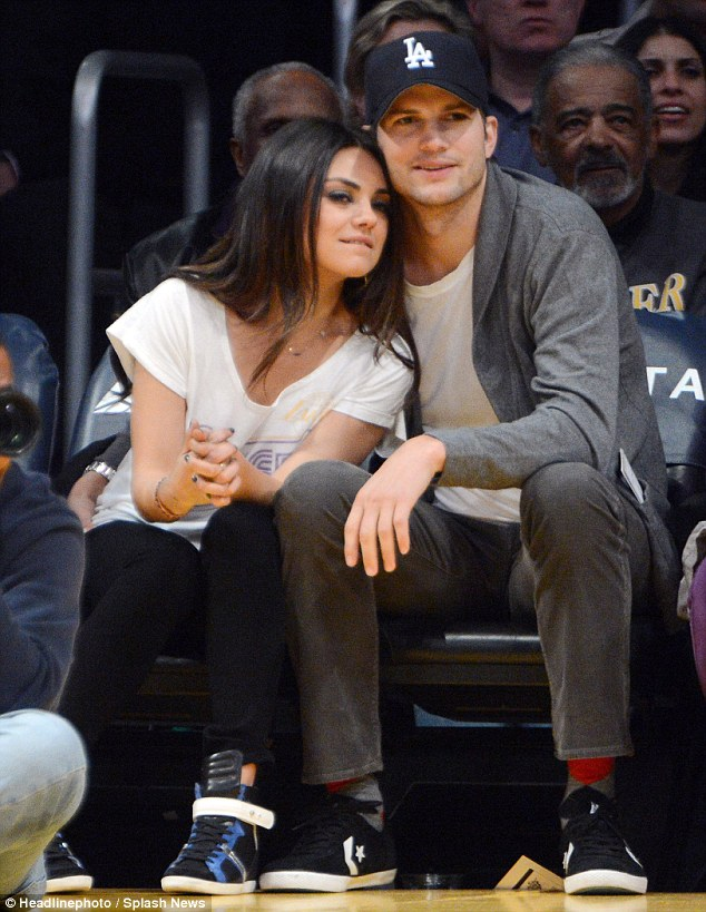 Have love will travel: Now dating for around a year and a half, the couple, seen here at a basketball game earlier this year, looked loved up as the visited the sights of China
