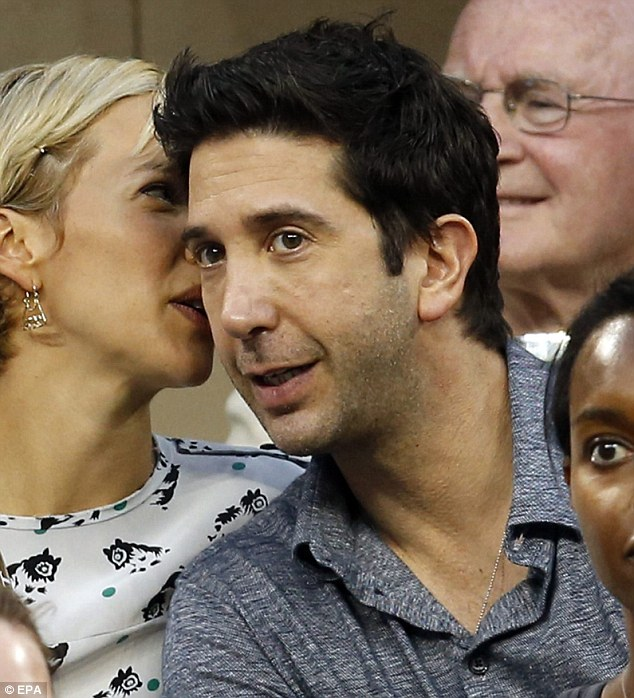 Sweet nothings: Zoe whispered into David's ear during the match