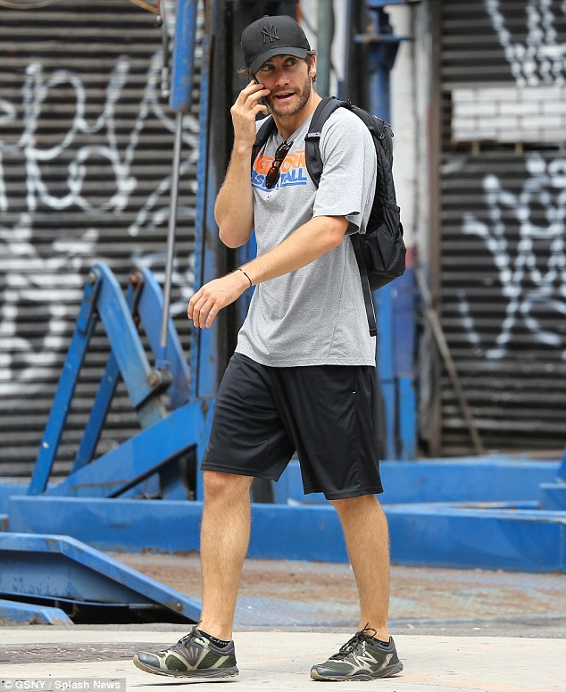 Relaxed casual: Earlier in the day the Donnie Darko actor went for a walk wearing black basketball shorts, a grey T-shirt, his favourite black New York Yankees hat and sneakers