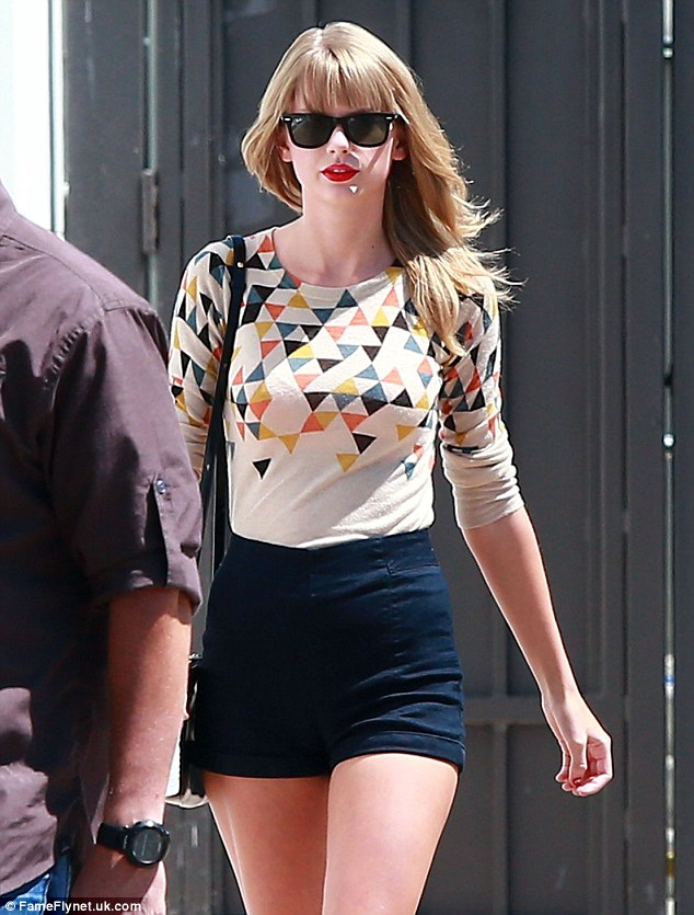 Summertime chic: Taylor finished her look off with a slick of her favourite red lipstick and some shades