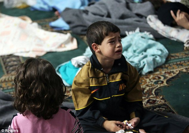 Attack: A boy who survived the chemical attack on the eastern suburbs of Damascus two weeks ago