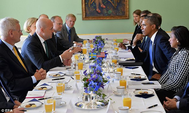 Meeting: Mr Obama with his national security team at a breakfast summit with Swedish officials