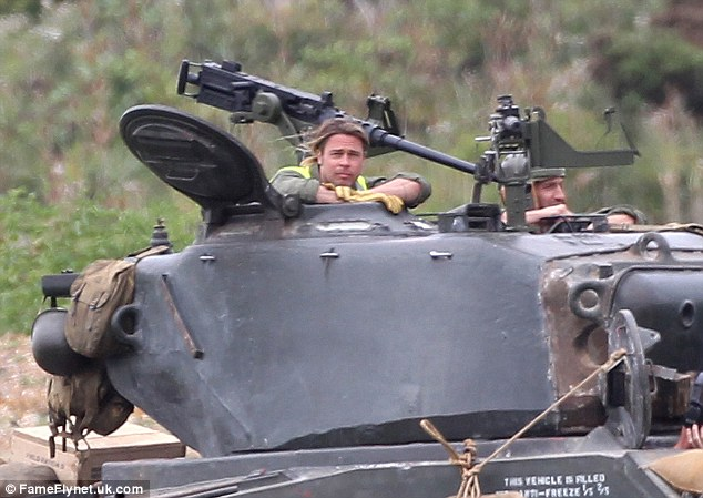 He fits right in: Brad looked the part in his army greens as he learnt the basics for his new war film Fury