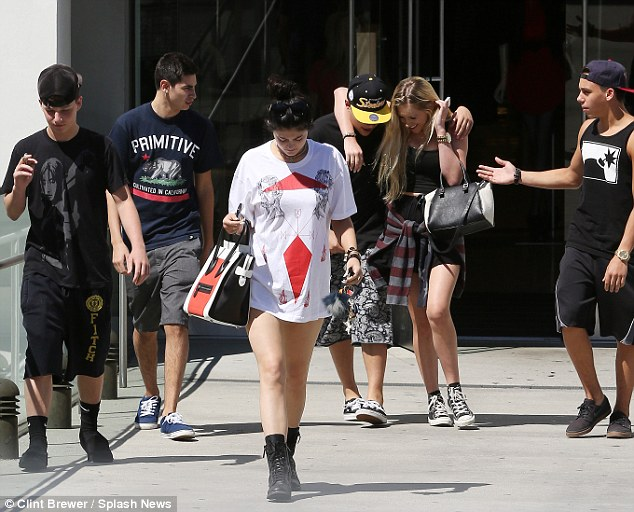 Leader of the mall pack: For her day out shopping with friends at Bloomingdale's, Kylie wore the white T-shirt - which featured a Leonardo da Vinci inspired line drawings - like a very short dress, adding a pair of combat boots