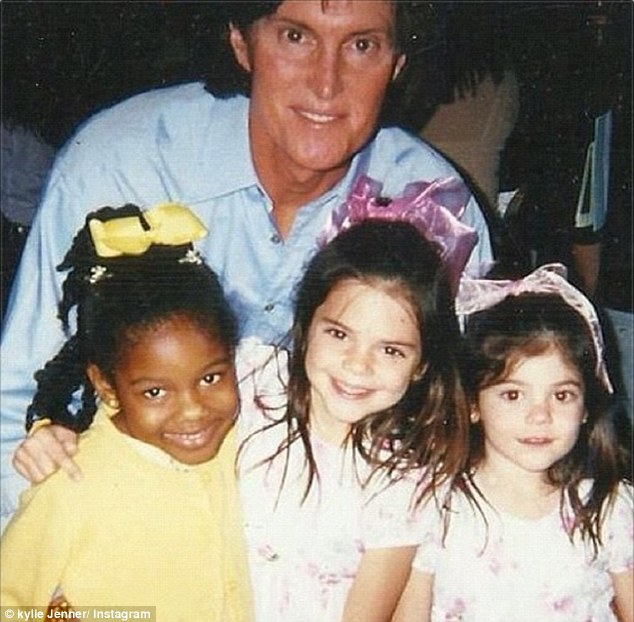 She's come a long way: Before the designer handbags there were big pink bows, as Kylie showed in an Instagram picture she posted of her father Bruce, sister Kendal and friend Rachel Marie