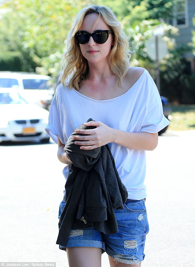 Low-key look: The 23-year-old daughter of Hollywood actress Melanie Griffith and actor Don Johnson, was casual in a loose-fitting white T-shirt and a pair of ripped denim Daisy Dukes, which showed off her slender and pale legs